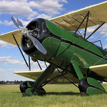 Flying Heritage Collection Waco airplane sitting on Grass