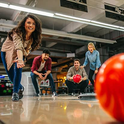 Friends having fun at bowling alley
